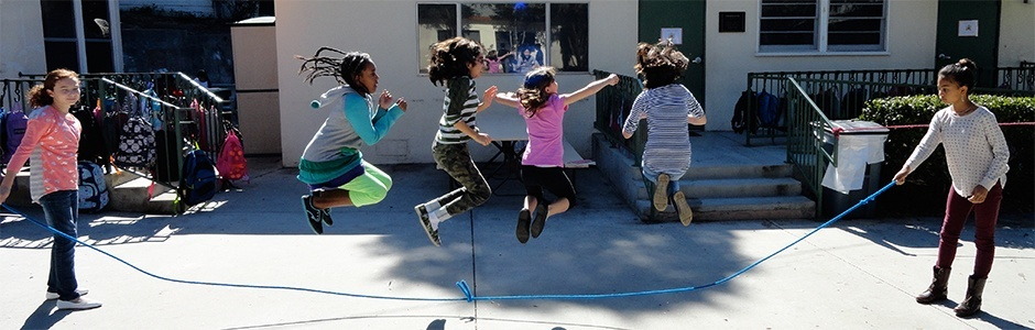 Students jumping rope on the playground.